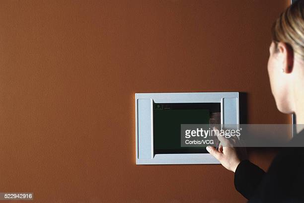 businesswoman using touch screen monitor - vcg stock pictures, royalty-free photos & images