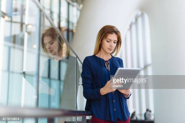 Businesswoman using touchpad for organization of daily tasks