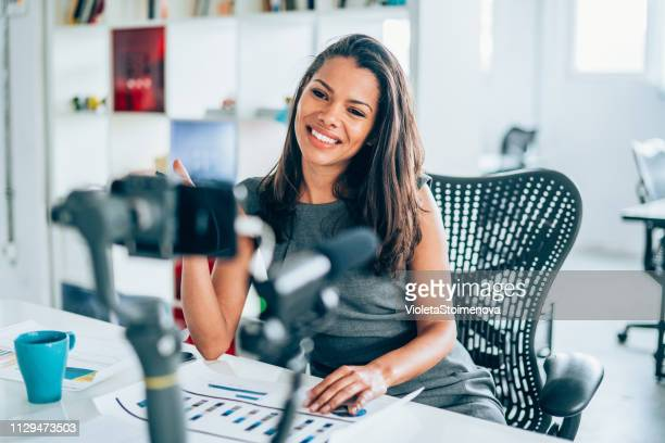 businesswoman vlogging at the office - vlogging stock pictures, royalty-free photos & images