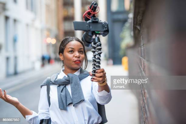 businesswoman vlogging in london - vlogging stock photos and pictures