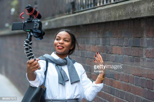 businesswoman vlogging in london - influencer stock photos and pictures