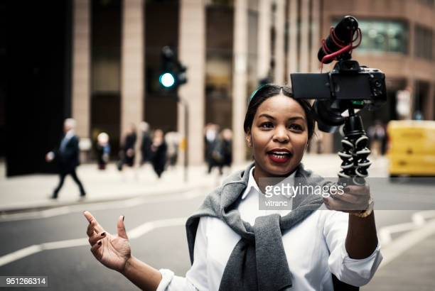 businesswoman vlogging in london - journalism stock pictures, royalty-free photos & images