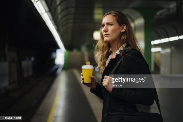 businesswoman waiting for a train - waiting stock pictures, royalty-free photos & images