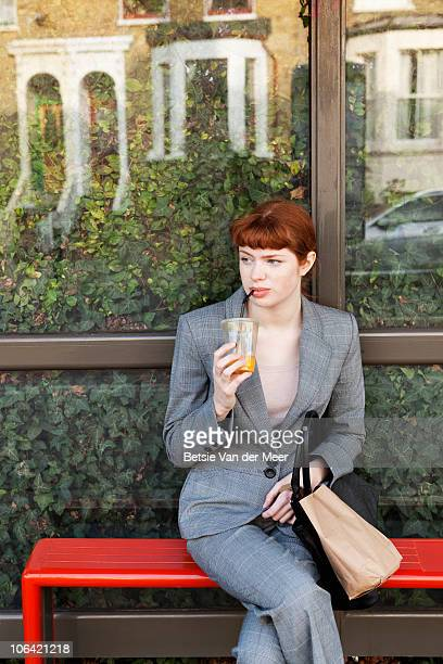 Businesswoman waiting for bus to work.