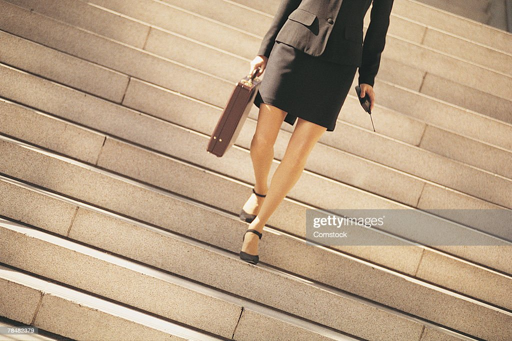 Woman walking down stairs stock image. Image of nature