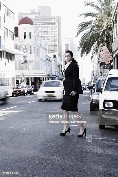 Businesswoman Walking in Street