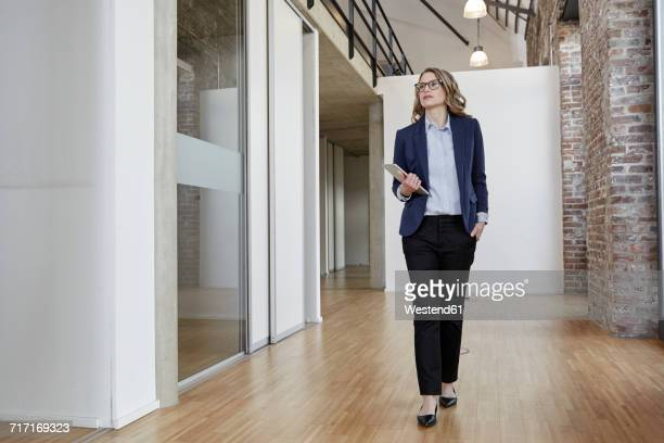 Businesswoman walking on modern office floor