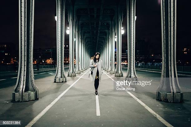 Businesswoman walking on Pont de Bir-Hakeim