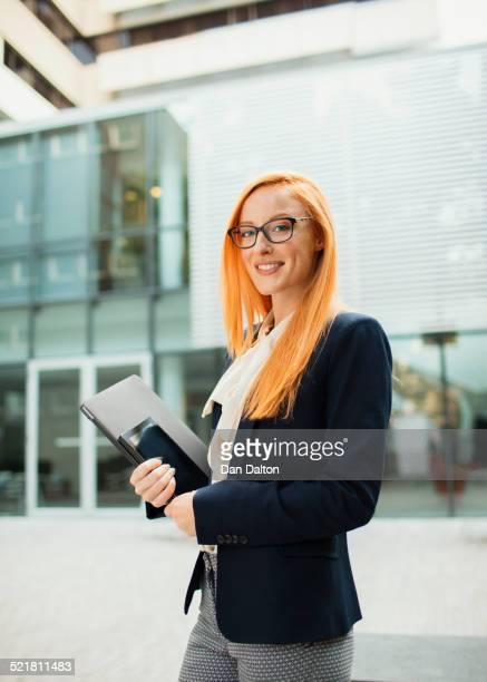 Businesswoman walking outside of office building