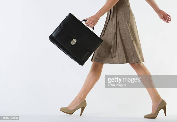 businesswoman walking - briefcase stock pictures, royalty-free photos & images