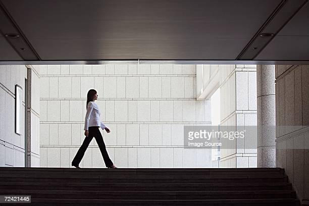 businesswoman walking - striding stock pictures, royalty-free photos & images