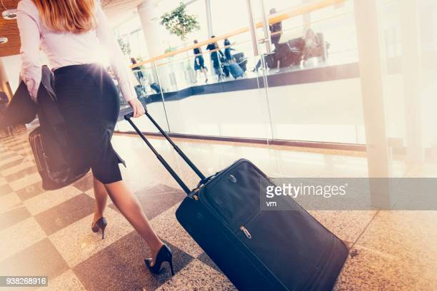 Businesswoman walking through an airport terminal