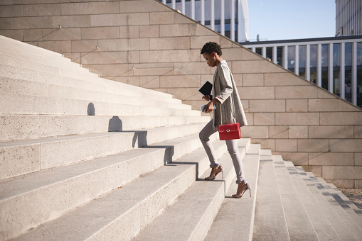 Businesswoman walking up stairs - gettyimageskorea