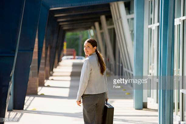 Businesswoman walking with a briefcase