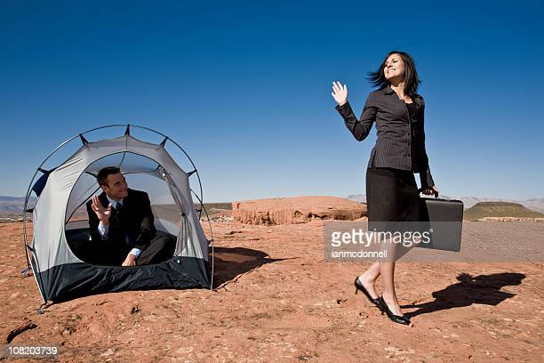 businesswoman waving goodbye from tent