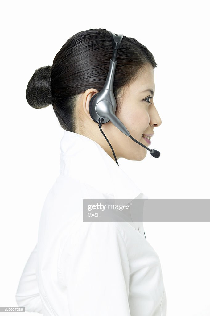 Businesswoman Wearing a Headset : Stock Photo