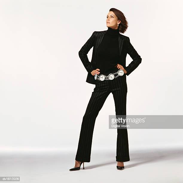 Businesswoman Wearing a Pinstripe Suit and a Belt Made of Clocks