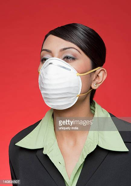 businesswoman wearing a pollution mask - flu mask stock photos and pictures