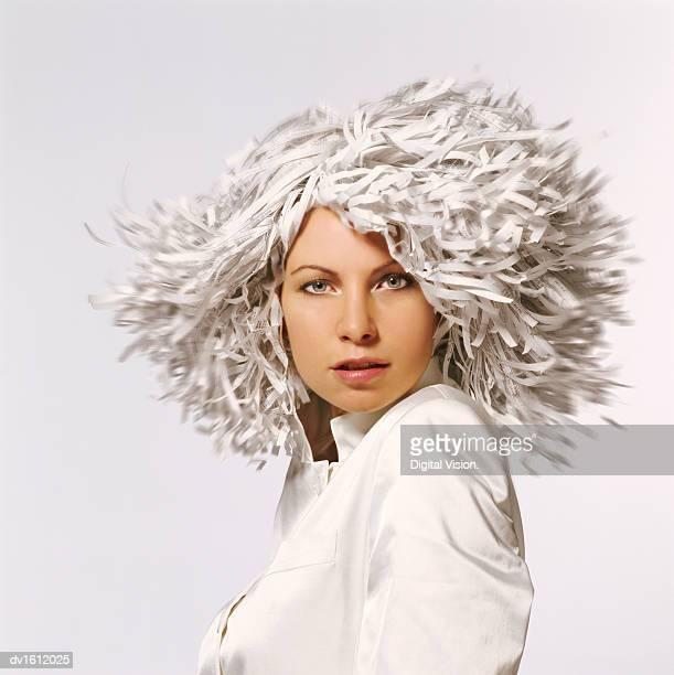 businesswoman wearing a wig made of shredded paper - kopfbedeckung stock-fotos und bilder
