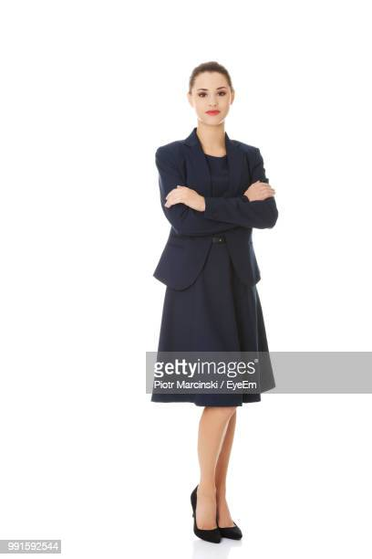 businesswoman wearing black suit against white background - anzug stock-fotos und bilder