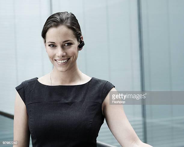 Businesswoman wearing bluetooth device