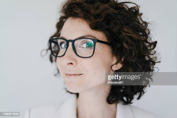 Businesswoman wearing glasses, looking confident