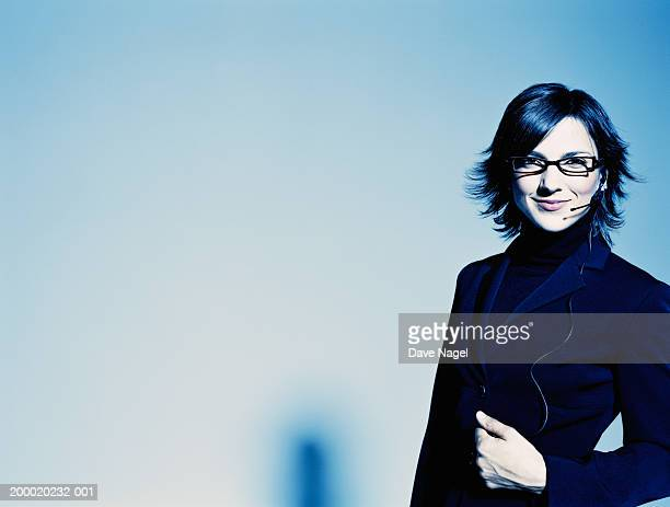 businesswoman wearing headset, close up - gel effect lighting stock photos and pictures