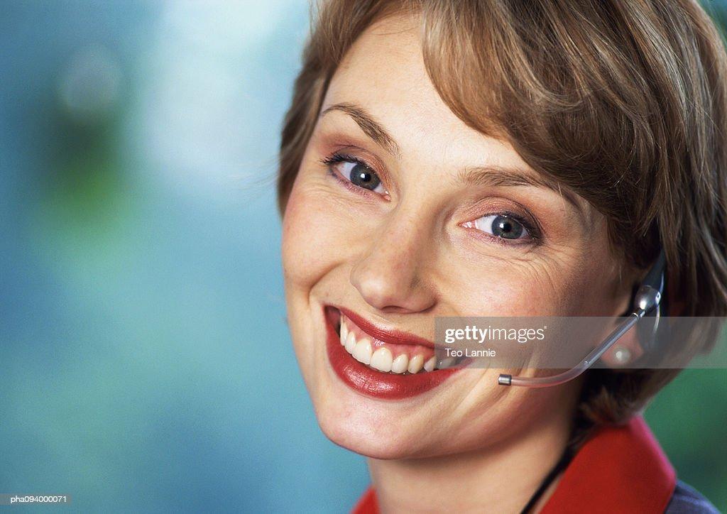 Businesswoman wearing headset, close-up, portrait : Stockfoto
