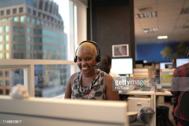 businesswoman wearing headset in office callcenter - hands free device stock pictures, royalty-free photos & images
