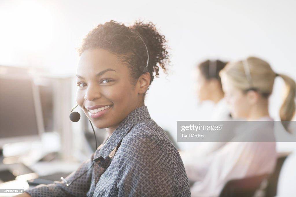 Businesswoman wearing headset in office : Stock Photo