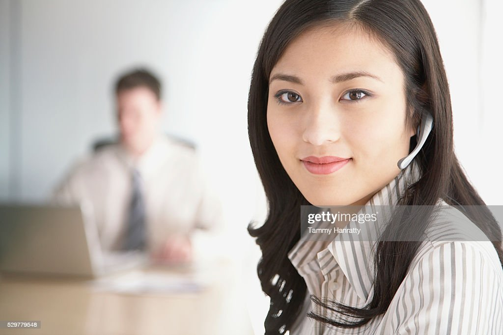 Businesswoman wearing headset : Foto de stock