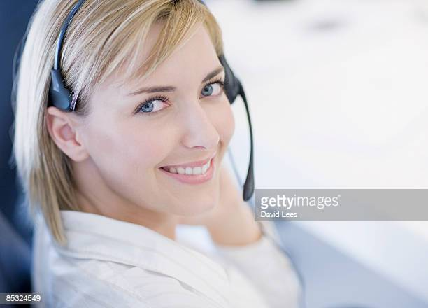 businesswoman wearing headset, smiling, portrait - communication occupation stock pictures, royalty-free photos & images