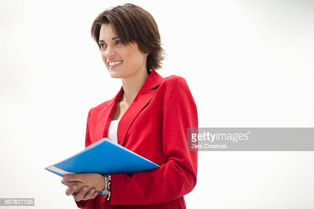 Businesswoman wearing red jacket, portrait