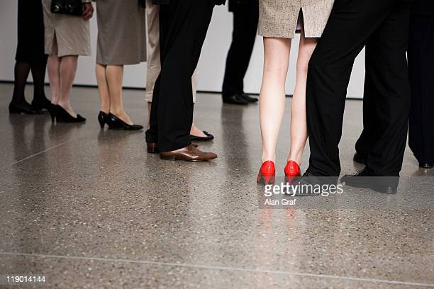 Businesswoman wearing red shoes