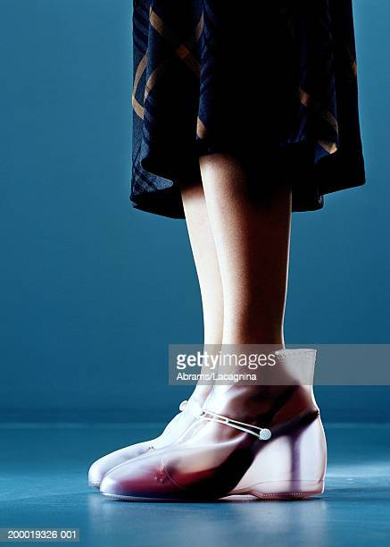 businesswoman wearing rubber boots over shoes - shoe covers stock pictures, royalty-free photos & images