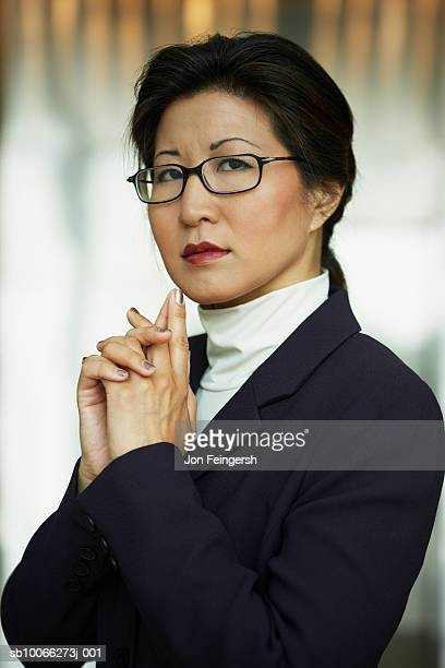 Businesswoman wearing spectacles, close-up, portrait