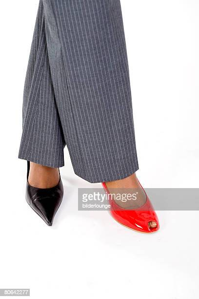 businesswoman wearing two different shoes - mismatched clothes stock pictures, royalty-free photos & images