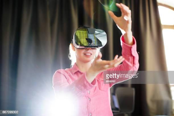 Businesswoman wearing virtual reality glasses