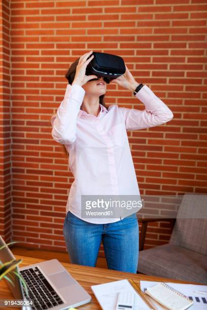 Businesswoman wearing VR glasses in office