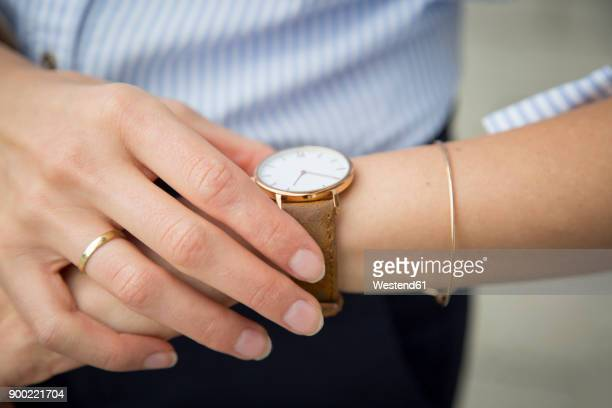 businesswoman wearing wrist watch, close-up - wrist watch stock pictures, royalty-free photos & images