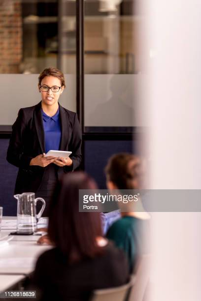 Businesswoman while giving presentation in office