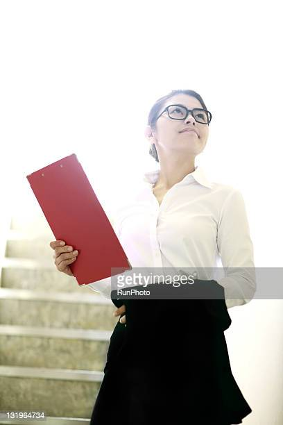 businesswoman with a binder