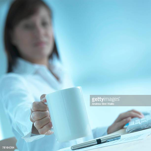 Businesswoman with a coffee cup