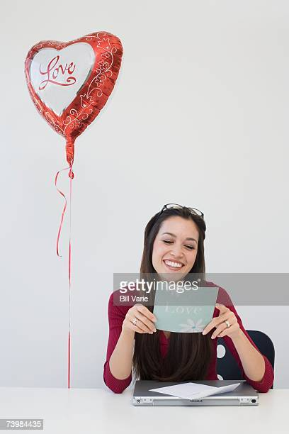 Businesswoman with a heart shaped balloon