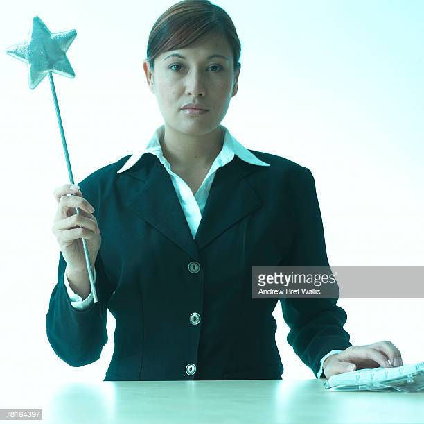 businesswoman with a magic wand - zakelijke kleding stock pictures, royalty-free photos & images