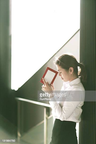 businesswoman with a postcard
