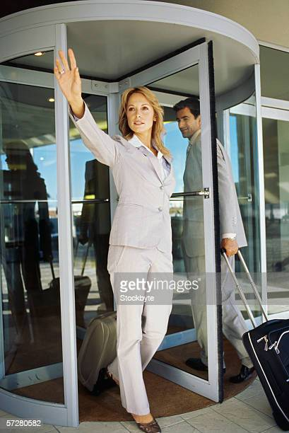 Businesswoman with a suitcase hailing a taxi