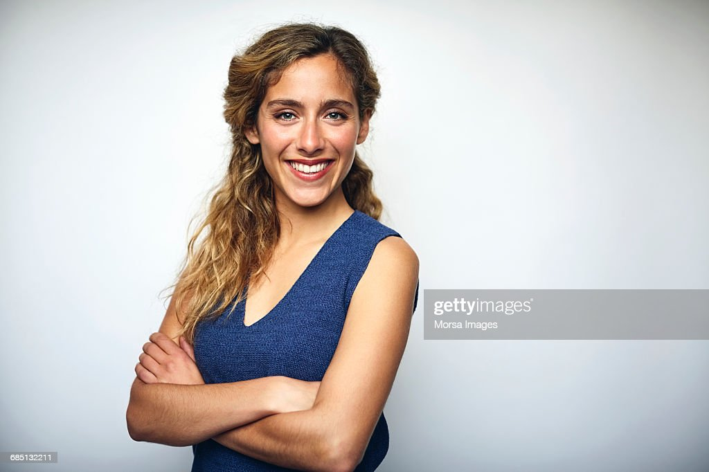 Businesswoman with arms crossed over white : Stock Photo