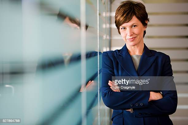 businesswoman with arms crossed - jim craigmyle stock pictures, royalty-free photos & images