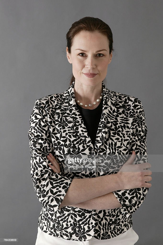Businesswoman with arms crossed : Stockfoto